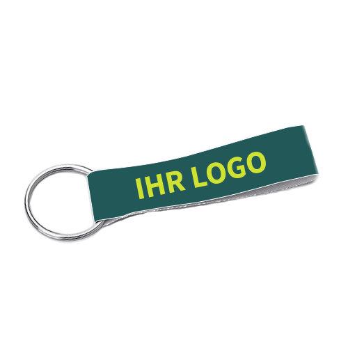 Schlüsselanhänger aus Stoff mit Logo bedrucken 2,5 x 8,5 cm. Ein gutes Werbegeschenk/Giveaway..