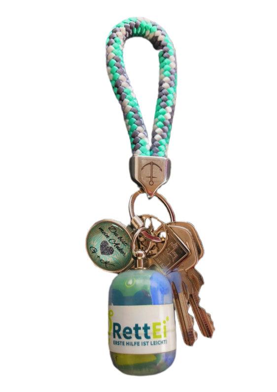 Erste-Hilfe Schlüsselanhänger mit Beatmungstuch als Beatmungshilfe in transparent mit Nitril Einmalhandschuhe