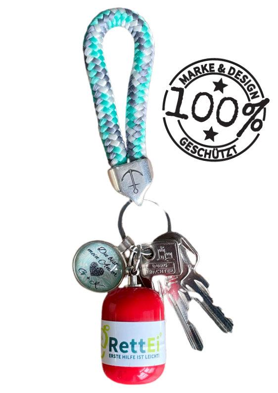Erste-Hilfe Schlüsselanhänger von RettEi mit Beatmungstuch als Beatmungshilfe in ROT mit Nitril Einmalhandschuhe